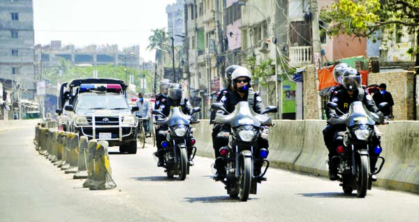 Different law enforcing agencies including RAB patrolling on the city streets to beef up security measures. The snap was taken from Chankharpool area on Saturday.