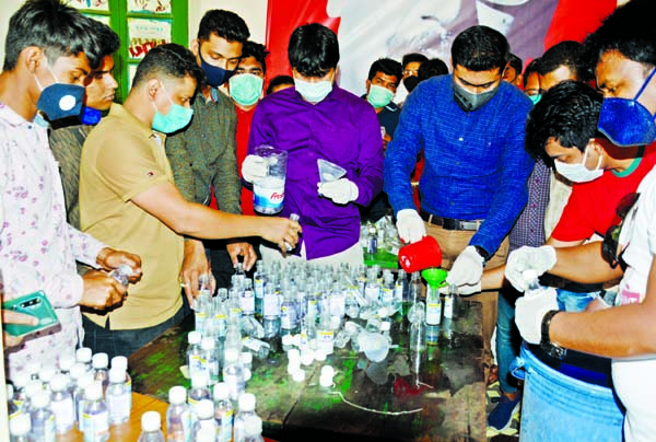 Bangladesh Chhatra League leaders and activists producing hand Sanitiser to distribute among the people free of cost. This photograph was taken from Madhu's Canteen on Sunday.