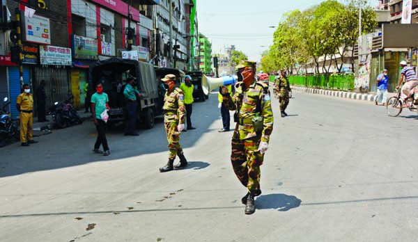 Army personnel conducting awareness build-up miking against coronavirus in city's English Road area on Sunday.