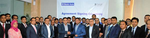 Mohd. Ziaul H Molla, Deputy Managing Director of Bank Asia Ltd and Mufakkharul Islam Khasru, Managing Director of Finlay Properties Limited, exchanging documents after signing an agreement at the bank's Chattogram Zonal Office recently. Under the deal, the bank will facilitate buyers of Finlay Properies Limited through providing Home Loan at faster process with privileged rate.