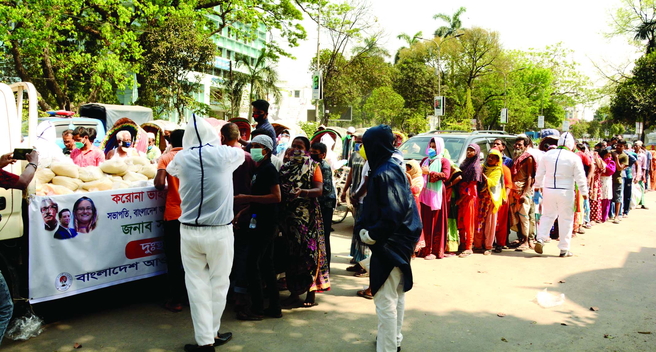 Different government and non-government organisations distributing food among the day-labourers and destitute. The snap was taken from the High Court area on Tuesday.