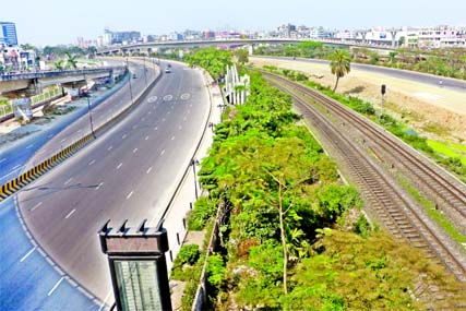 Roads stretching to Dhaka Airport look deserted on Tuesday due to the suspension of transport services in Dhaka and across the country to contain spread of coronavirus.