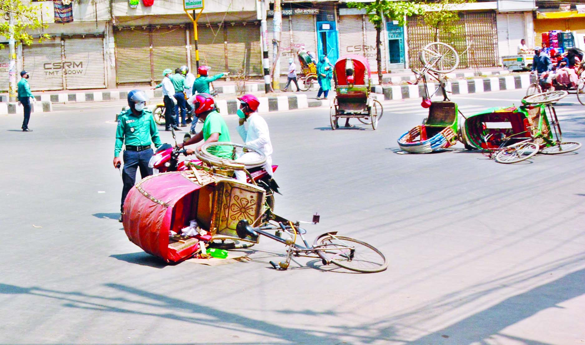 Police prevent rickshaws to ply on city roads on Wednesday as people started moving out of their homes defying the government's stay home order amid coronavirus outbreak.