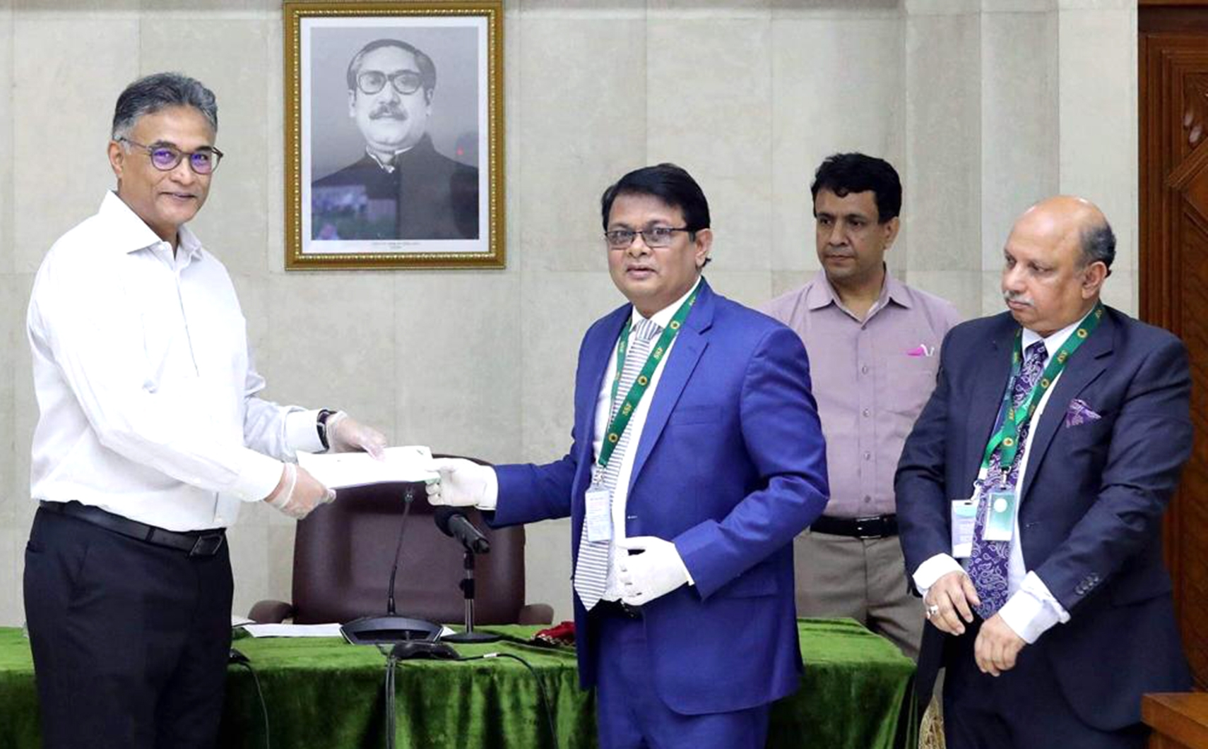 M. Reazul Karim, Managing Director of Premier Bank Limited, handing over a cheque of Tk. 5 crore to the Prime Minister's relief fund to combat the spreading of Covid-19 to Ahmad Kaikaus, Principal Secretary of Prime Minister at PMO recently. Syed Nowsher Ali, DMD of the bank, was also present.