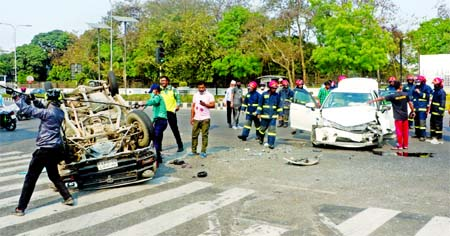 A car turns turtle after hitting another one on the road in front of the Prime Minister
