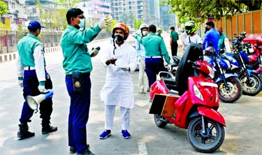 Traffic police intercept bikers as they take to the road on Thursday ignoring the government