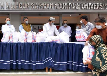 Local lawmaker Elias Uddin Mollah, on behalf of Bangabandhu Sheikh Mujibur Rahman Maritime University, distributing essential food sttuff among the poor at Pallabi area in the city recently. Rear Admiral M Khaled Iqbal, Vice-Chancellor of the university was also present.