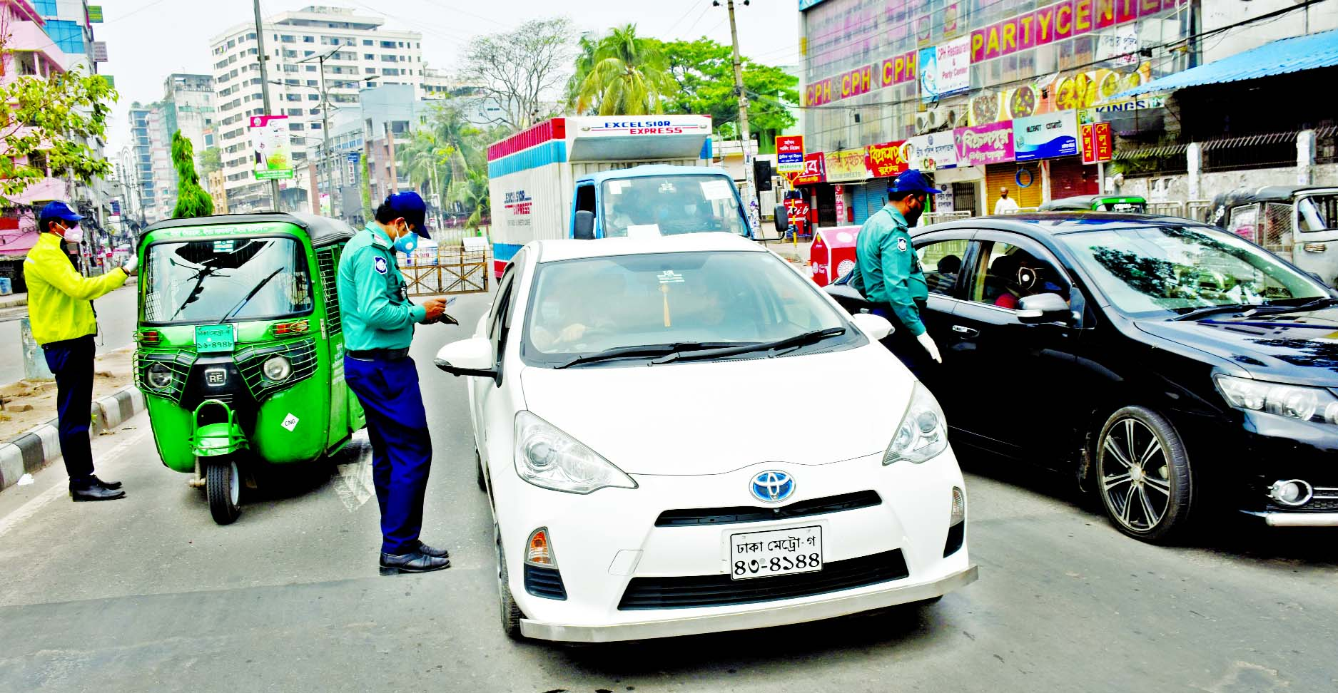 Police personnel intercept motor vehicles at Paltan in Dhaka on Friday as the law enforcers intensify restriction on people