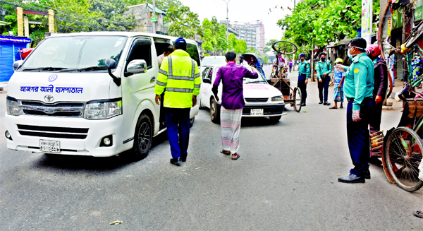 An ambulance faces police checking at Swamibagh area in the capital on Wednesday as such vehicles carrying passengers deceiving the law enforcers during the ongoing shutdown in Dhaka.