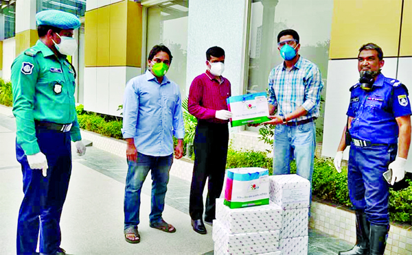 Secretary General of Trimatrik-30 BCS Officers' Co-operative Society Limited Dr. Latiful Bari handed over Personal Protection Equipments to the Superintendent of  Central Police Hospital in the city on Tuesday to tackle coronavirus.