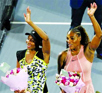 Williams sisters stretch it out with yoga treat for fans