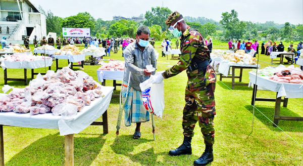 Members of Bangladesh Army providing medial aid and 'Sena bazar' among the cyclone Amphan affected people and also resisting coronavirus at Sheikh Kamal International Cricket Stadium in Cox's Bazar on Friday.