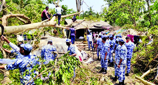 Members of Bangladesh Air Force engaged in removing uprooted and broken trees in the cyclone Amphan-hit areas. The snap was taken from Bhasanchar, Patuakhali on Friday.
