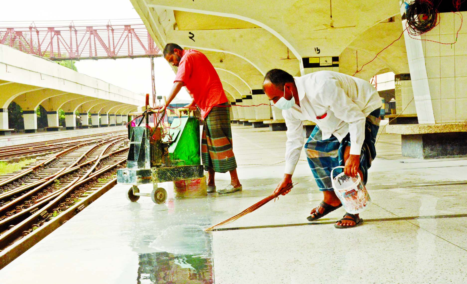 Workers cleaning the Kamalapur Railway Station on Friday morning as the authorities decided to resume the operation of the intercity trains on a limited scale from May 31 which stopped since March 24 to fight the coronavirus outbreak.