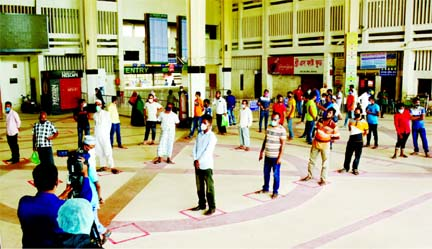 People throng the Kamlapur Railway Station in Dhaka for tickets on Saturday as eight intercity trains starts operations from today (Sunday). But they return empty handed as the authorities decided to sell tickets online to ensure health safety of passengers.