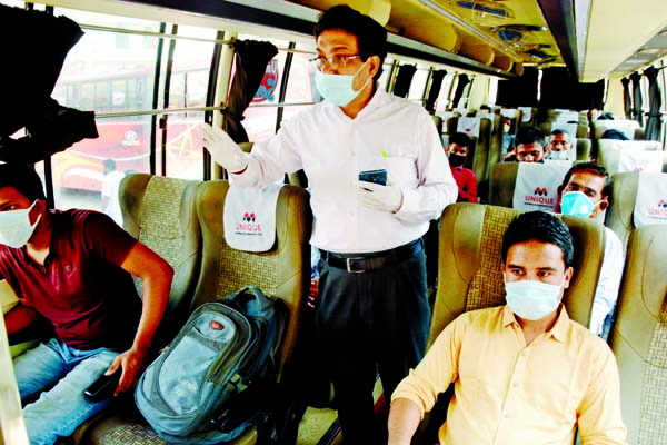 An Executive Magistrate of Road Division seen to supervise the plying of long-route buses. The snap was taken from Dhaka-Chattogram Highway on Monday.