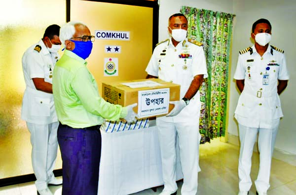 Members of Bangladesh Navy distributing Personal Protective Equipment to the doctors and nurses at Barguna Sadar Hospital recently to fight coronavirus.