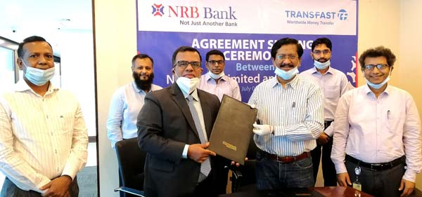 Md Mehmood Husain, Managing Director and CEO of NRB Bank Limited and Mohammad Khairuzzaman, Country Director-Bangladesh of Trans-Fast Remittance LLC (TRANSFAST), exchanging documents after signing an agreement at the Corporate Head Office of the bank in the city on Wednesday for disbursing remittance throughout the country. Md Khurshed Alam, Deputy Managing Director and Milton Roy, Head of Agent Banking Division & Foreign Remittance Department, among others, were present.