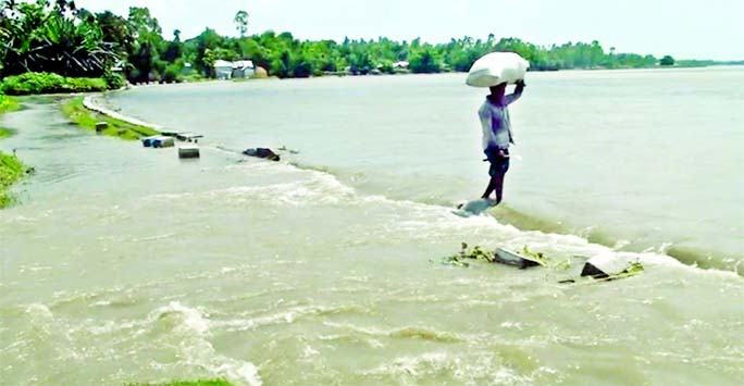 A vast area of Nagarpur upazila of Tangail goes under water after Ghonapara Dam damaged by strong current of Dhaleswari River.