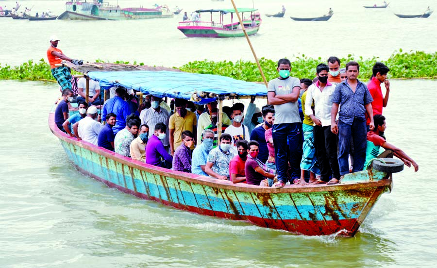 Commuters continue to cross the Buriganga River by wooden engine boat from Keraniganj to Dhaka everyday taking risk of lives even after seven days of the capsize 'Morning Bird' in the river that claimed 34 lives. This snap was taken on Monday.