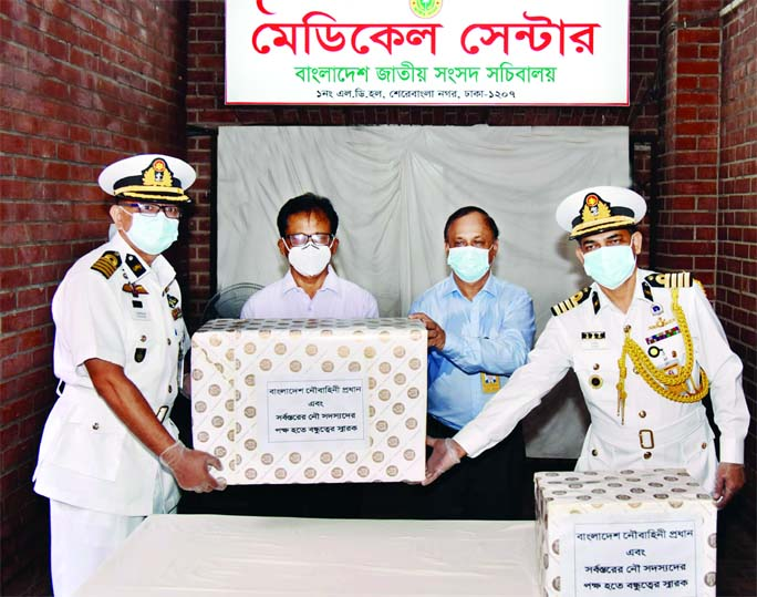 Bangladesh Navy distributes Personal Protective Equipment (PPE) to the Medical Center of Bangladesh Parliament Secretariat on Wednesday with a view to tackling Covid-19 pandemic