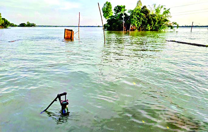 Everything goes under water even the tube-well, the only source of pure drinking water, as floodwater  submerged entire Nangla Union of Melandah in Jamalpur district. The photo was taken from Nailer Ghat Bazar on Wednesday.
