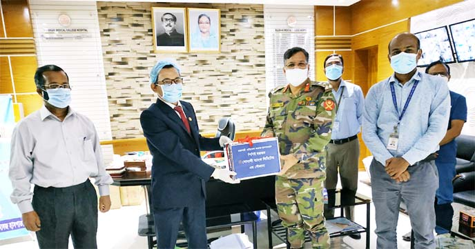 On behalf of Md Ataur Rahman Prodhan, CEO of Sonali Bank Limited, Mir Hasan Mohammad Zahid, Deputy General Manager (In-charge) of Rajshahi General Manager's office of the bank, handing over 200 set PPE for doctor & nurses uses to Brigadier General Md. Zamilu Rahman, Director of Rajshahi Medical Hospital on Thursday. Others officers of the bank were also present.