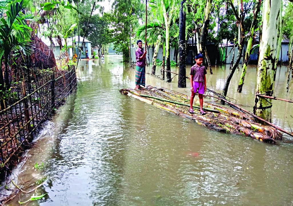 80,000 people marooned in N-dists Flood situation worsens in Sunamganj, Sylhet