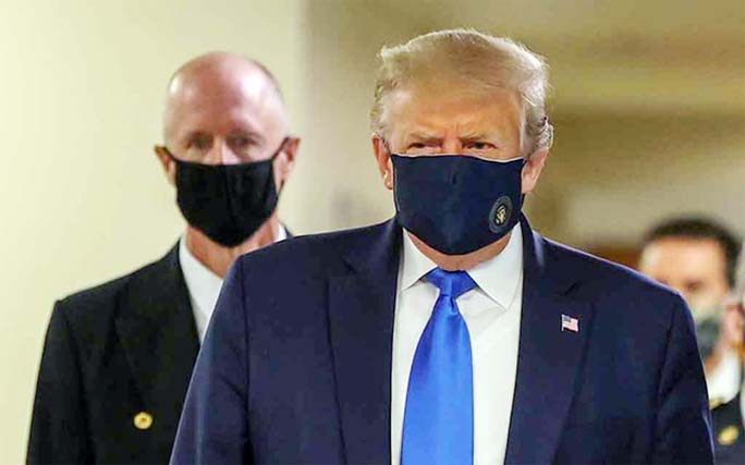 US President Donald Trump wears a mask while visiting Walter Reed National Military Medical Centre in Bethesda, Maryland on Saturday.