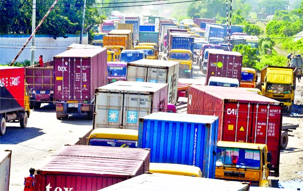 A huge gridlock at Saltgola crossing in Chattogram city on Thursday when dozens of container carriers come out from Chattogram Port after loading imported goods to deliver at different parts of the country.