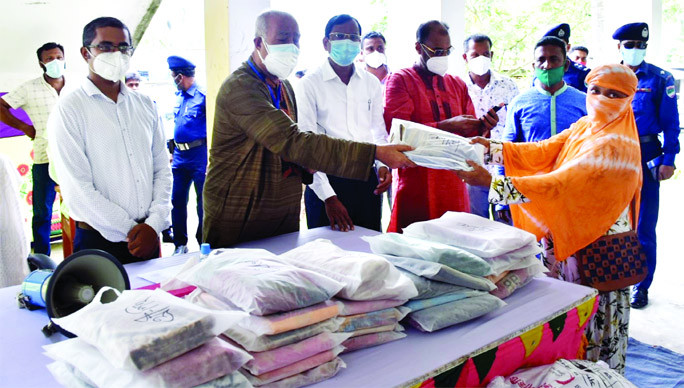 KCC Mayor Alhaj Talukder Khaleque distributes relief goods among poor people at different Unions of Rampal upazila on Wednesday.