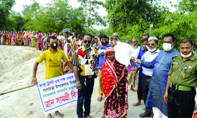 LGED, Rangpur Administrative officer Md. Jahid Latif distributes reliefs among the among 600 flood affected families at Kolkond Union and Binbinar Char area of Teesta River under Gangachara upazila in Rangpur on Wednesday on behalf of Soma Jahid,  Founder Chairman of Astha Trust Dhaka, a non-government organisation.