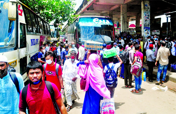 The home-bound Eid passengers gather at bus terminals caring none, even the health guidelines, risking transmission of coronavirus. The photo was taken from Mohakhali Bus Terminal.