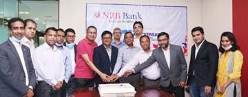 Mamoon Mahmood Shah, Managing Director & CEO (Current Charge) of NRB Bank Limited, cutting cake to celebrate the bank's 7th Anniversary with the slogan 'Marching Towards Success & Sustainability' at its Corporate Head Office in the capital on Tuesday. Md Khurshed Alam, Deputy Managing Director, was also present.