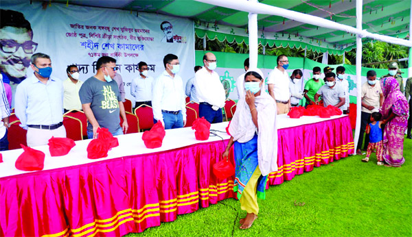 Officials of Bangladesh Cricket Board (BCB) distribute food to the distressed people in front of the Sher-e-Bangla National Cricket Stadium in the city's Mirpur marking the 71st birth anniversary of Shaheed Sheikh Kamal on Wednesday.