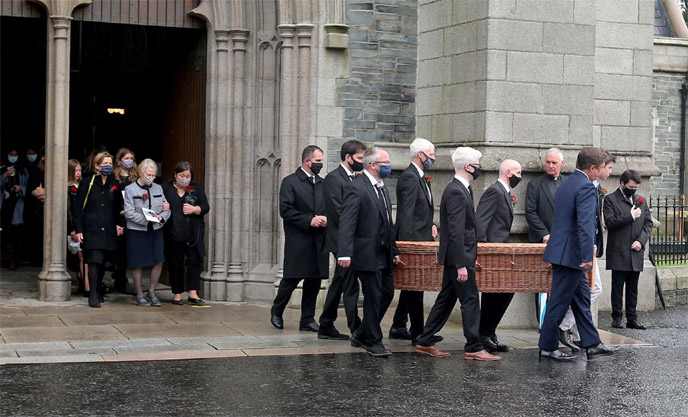 Giant of Northern Ireland peace Hume laid to rest in small service