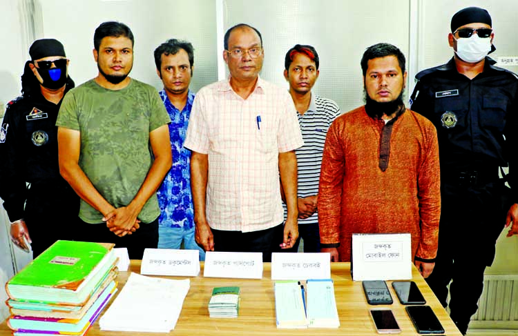 Members of RAB-3 and National Security Intelligence nab six persons with passport and other documents from the city's Hatirjheel area on Thursday for their allegedly involvement in illegal manpower export.
