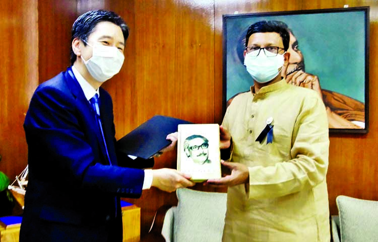 State Minister for Shipping Khalid Mahmud Chowdhury hands over a book on  'Bangabandhu's Unfinished Biography' to the Chief Representative of JICA in Bangladesh Yuhohayakawa when the latter calls on him at the ministry on Thursday.