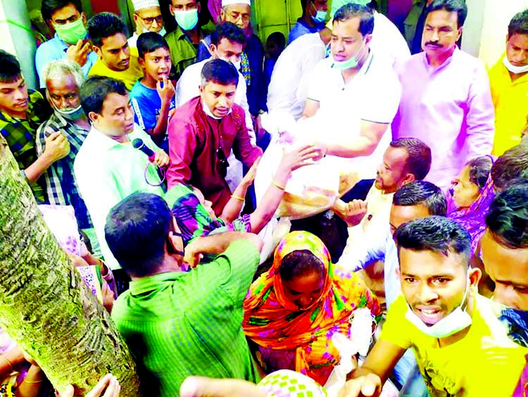 Mayor of Gazipur City Corporation Advocate Zahangir Alam distributes relief materials among the flood-affected people in Lathibhanga and Kaliakoir on Wednesday.