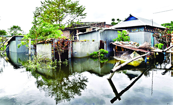Several houses and establishments at Kadamtoli in Keranigonj submerged by floodwater due to swelling in water level of the rivers around Dhaka. This photo was taken on Saturday.