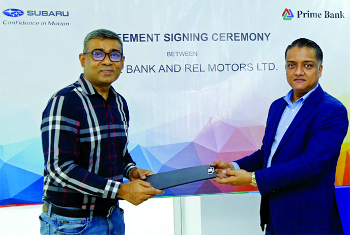 ANM Mahfuz, Head of Consumer Banking Division of Prime Bank Limited and Ahmed Saadat Momen, Director of REL Motors Limited, exchanging an agreement signing document at REL Motors corporate office in the city recently. Under the deal, both the company will initiate promotion of car loan and personal loan facilities with preferential offerings. Senior officials from both the organizations were present.