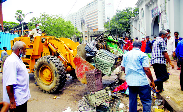 Dhaka South City Corporation conducts a drive on Sunday to evict illegal structures in front of Dhaka Medical College and Hospital.