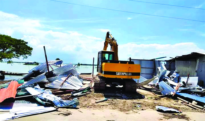 Kishorganj district administration conducts a drive on Monday to evict illegal structures and recovered government land at Karpasha in Nikli Haor Upazila of Kishorganj.