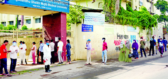 People are seen showing more interest nowadays in testing Coronavirus at public hospitals, when private hospitals are caught in fraudulence one after another with providing fake Covid-19 certificates. This photo, taken on Wednesday from Bangabandhu Sheikh Mujib Medical University, shows several people waiting in a long queue for testing.