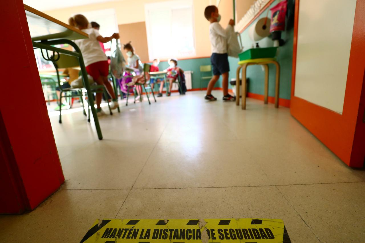 A social distancing mark is seen on the floor as pupils arrive on the first day of school after summer holidays amid the coronavirus outbreak, at Mariano Jose de Larra public school in Madrid, Spain on Tuesday.