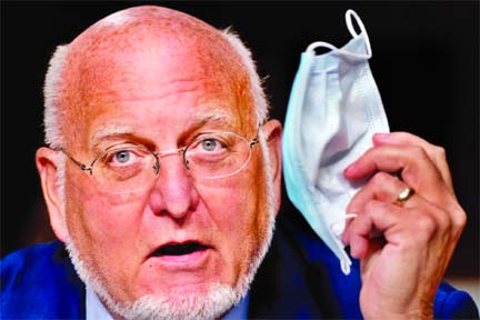 Masks may protect people better than future Covid-19 vaccine: CDC director