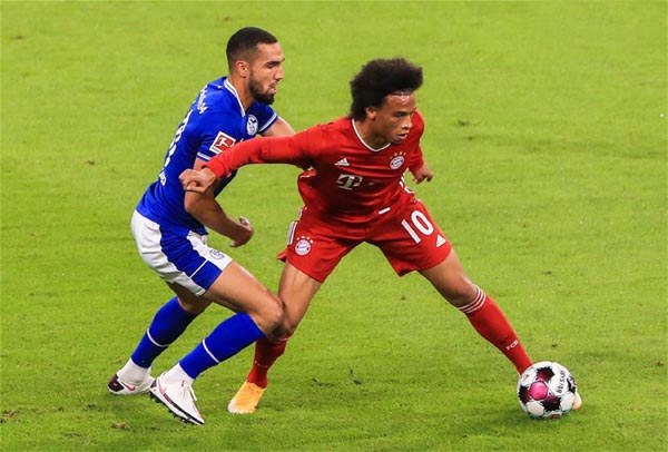 Leroy Sane (right) of Bayern Munich vies with Nabil Bentaleb of Schalke 04 during a German Bundesliga match in Munich, Germany on Friday.