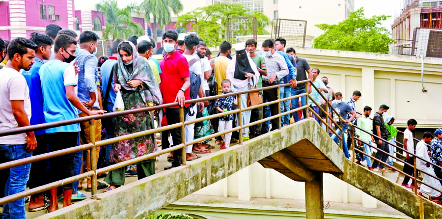 Pedestrians have to use the dilapidated foot over-bridge at Babubazar in the capital taking risk of accident as road adjacent to the bridge dug up by civic bodies for development works. This photo was taken on Sunday.