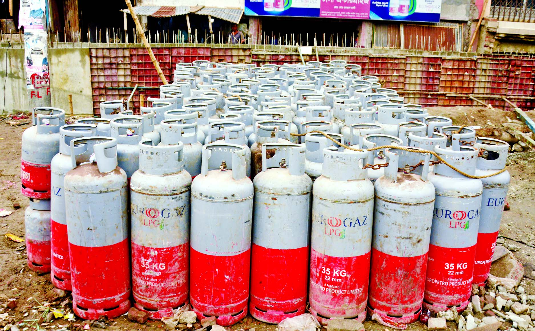 LPG cylinders are found piled up at an open space besides the residential area of Kazla in the capital on Tuesday, as most traders are reluctant to safely store cylinders.