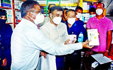 A mobile court of the Rapid Action Battalion (RAB) on Wednesday conducts a drive at surgical market in Gafur Tower in the city's Topkhana road and fines 14 shops around Tk 15 lakh for selling unapproved and sub-standard  medical protective equipment including pulse oxy-metre, N-95 masks and others.